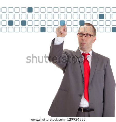 Businessman taping on some buttons - stock photo
