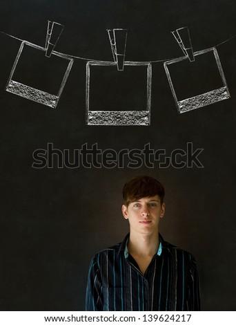Businessman, teacher or student with chalk polaroid style photographs on clothes line blackboard background - stock photo