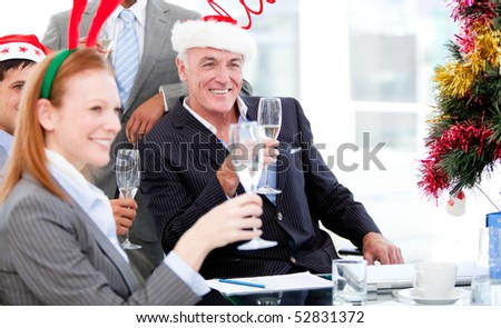 Businessman team celebrating christmas in the company - stock photo