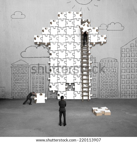 businessman teamwork for puzzles in arrow shape on doodles wall - stock photo