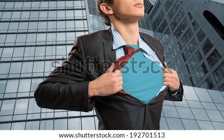 businessman tearing his shirt under her blue clothes super hero - stock photo