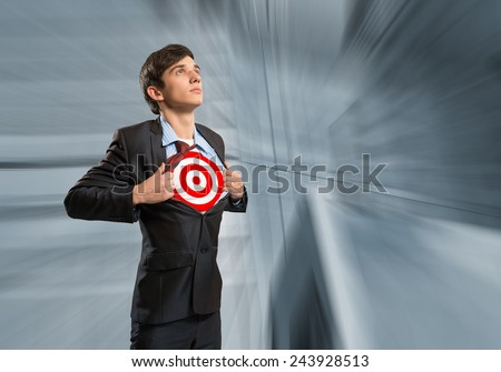 businessman tearing his shirt, under which is a target - stock photo