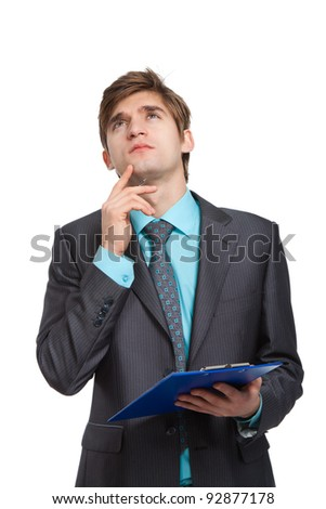businessman think looking up, while writing on clipboard, handsome young business man look up to empty copy space, wear elegant suit and tie isolated over white background - stock photo