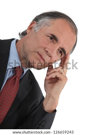 Businessman thinking alone - stock photo