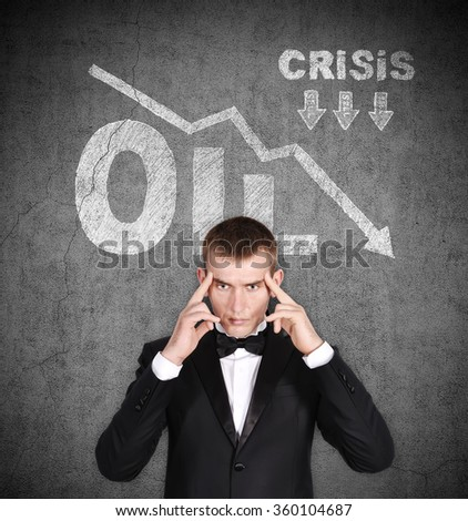 businessman thinking and drawing collapse in oil prices over head - stock photo