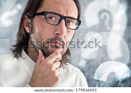 Businessman thinking and questioning. Portrait of thoughtful business person. - stock photo