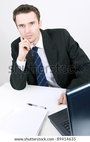Businessman thinking dreaming at his work office, made in studio on bright background - stock photo