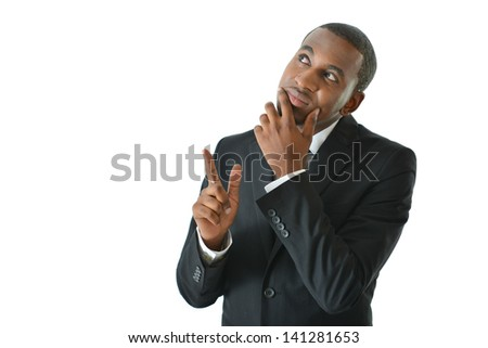 Businessman thinking of solutions and pointing - stock photo