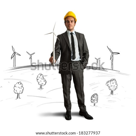 Businessman thinks about wind turbine energy project - stock photo