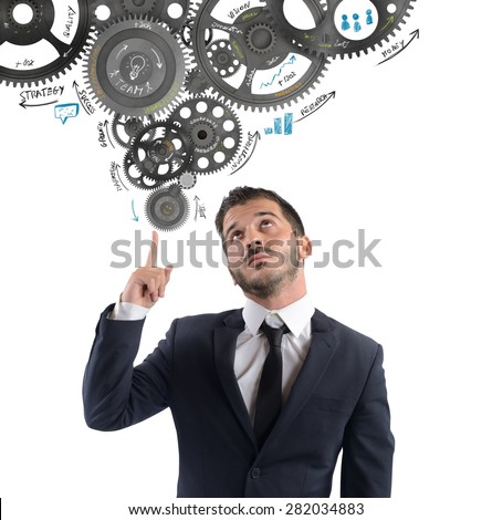 Businessman thought to a mechanism for idea - stock photo