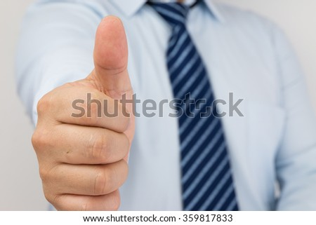 Businessman thumbs up - stock photo