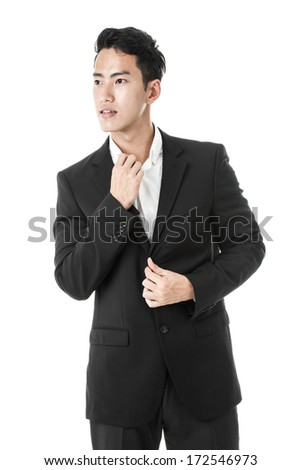 Businessman tidying up his suit - stock photo
