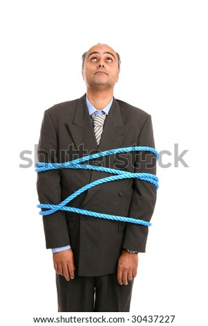 businessman tied up by angry co-workers - stock photo