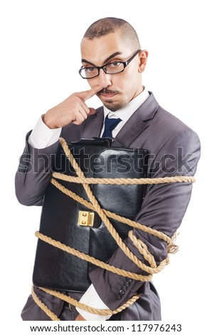 Businessman tied up with rope - stock photo