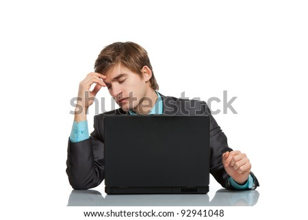 businessman tired stressed, depressed concept, handsome young business man working on laptop, using computer at the desk, wear elegant suit, isolated over white background - stock photo