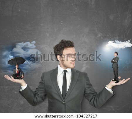 Businessman torn between being positive or negative - stock photo
