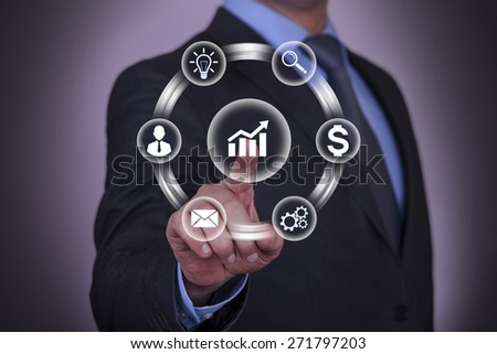 Businessman Touch Graph - stock photo