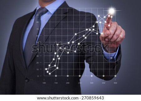 Businessman Touch Graph on Visual Screen - stock photo
