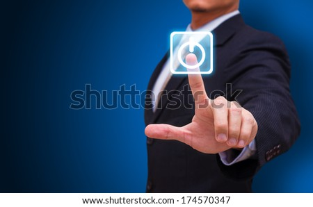 Businessman touch on power button - stock photo