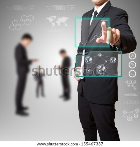 businessman touch screen with graph high technology - stock photo
