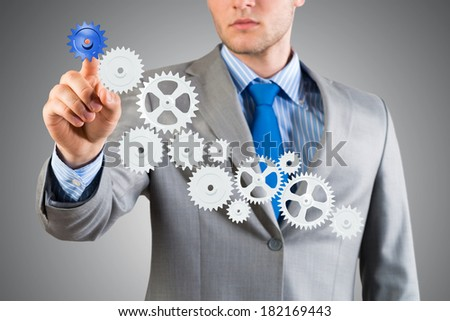 businessman touch the mechanism, run a successful business concept - stock photo