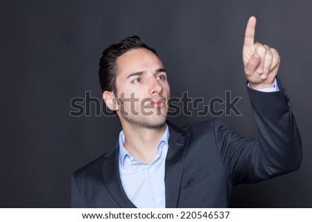 businessman touching a virtual cyberspace screen - stock photo