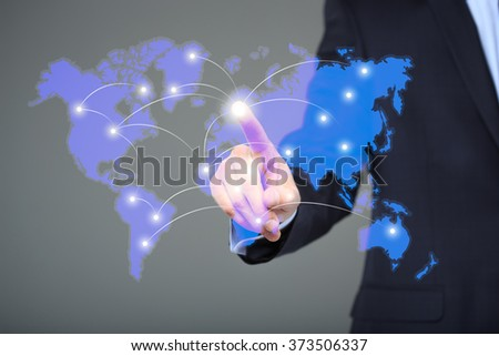 businessman touching a world map on the screen showing global connection between different continents. - stock photo