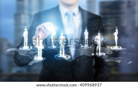 Businessman touching businessperson silhouette icon on networking system - stock photo