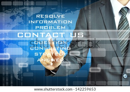 Businessman touching CONTACT US sign on visual screen - stock photo