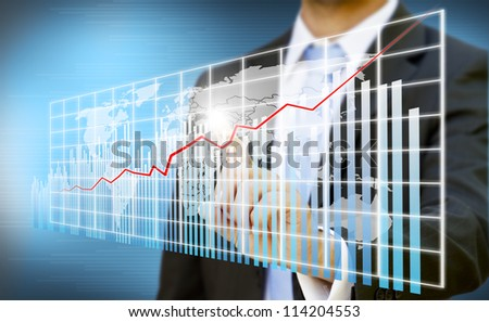 Businessman touching digital graphic - stock photo