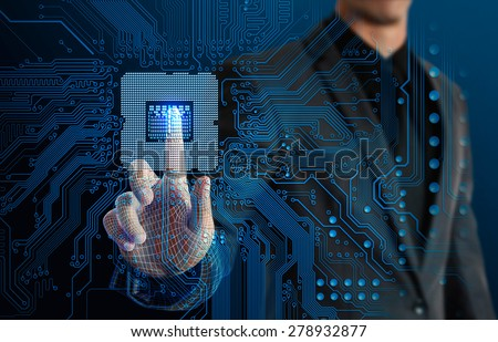 businessman touching glow CPU and electronics circuit - stock photo