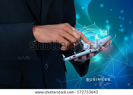 Businessman  touching mobile screen - stock photo