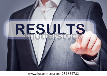 Businessman touching Results Button on virtual screen - stock photo