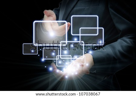 Businessman touching the button isolated on black - stock photo