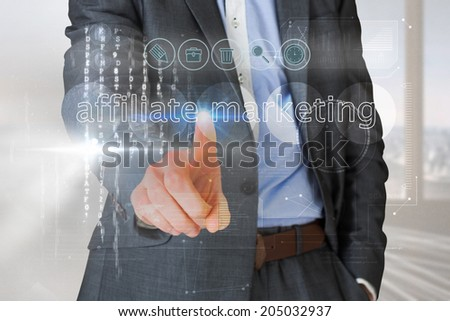 Businessman touching the words affliate marketing on interface against abstract white line design in room - stock photo