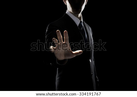Businessman Touching Transparent Screen - stock photo
