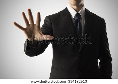 Businessman Touching Transparent Screen - stock photo