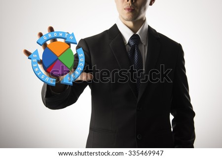 Businessman Touching Transparent Screen With Various Icons - stock photo