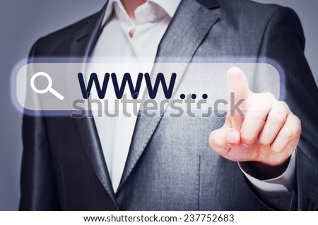Businessman touching web search bar on virtual screen. Networking concept - stock photo