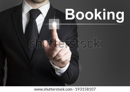businessman touchscreen booking - stock photo