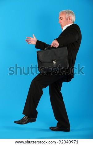 Businessman treading carefully - stock photo