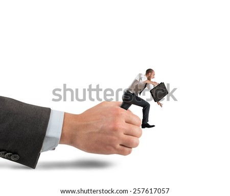 Businessman trying to get away from work - stock photo
