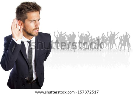 businessman trying to listen on a crowd - stock photo