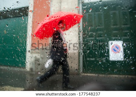 businessman under the rain - stock photo