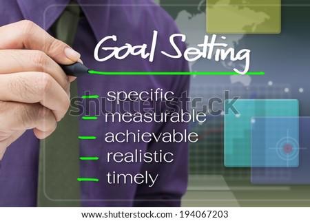 Businessman underline Goal Setting word concept on screen - stock photo