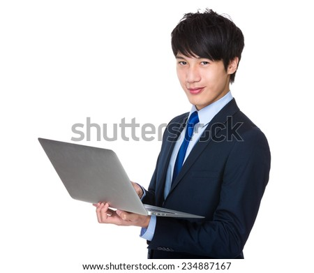 Businessman use of notebook - stock photo