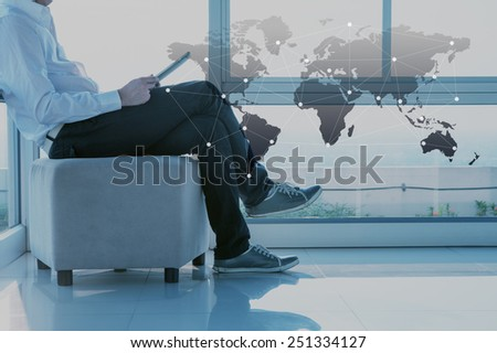 Businessman use tablet, business globalization concept - stock photo