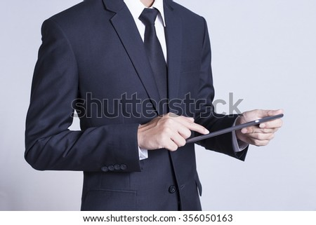 Businessman Use Tablet on Isolated White Background - stock photo