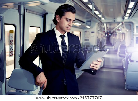 Businessman uses the new media technologies and devices to work successfully, mature man holding digital tablet, adult man is using a Tablet PC - stock photo