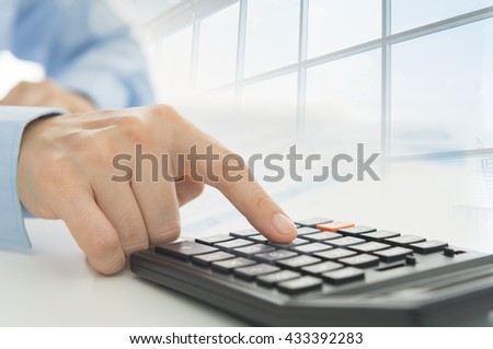 Businessman using a calculator to calculate the numbers. Accounting , Accountancy Concept. - stock photo